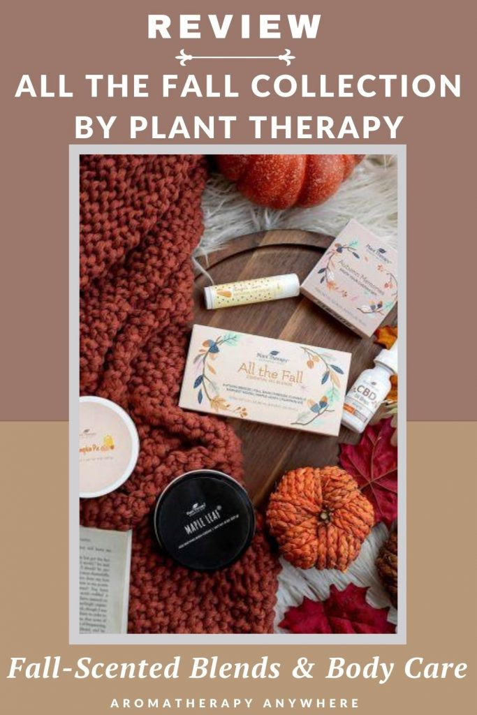 fall scene with pumpkins, sweater and essential oil bottle